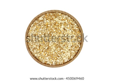 a mixture of salt and spices in a wooden dish on a white background - stock photo