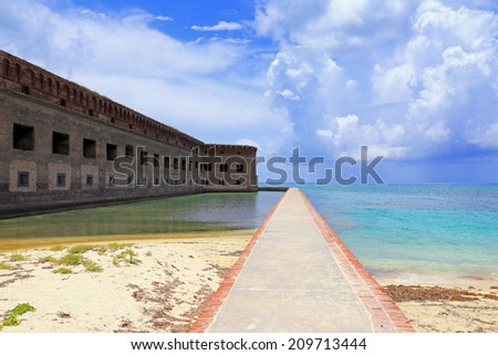 A moat wall affords a half-mile walk around the circumference of Fort Jefferson in Dry Tortugas National Park, Florida. - stock photo
