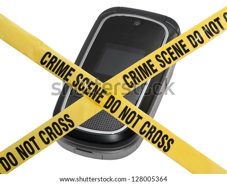 A mobile cell phone is blocked by yellow police tape reading Crime Scene Do Not Cross. The concept represents compromised technology, identity theft, & modern technology crime. Isolated on white. - stock photo