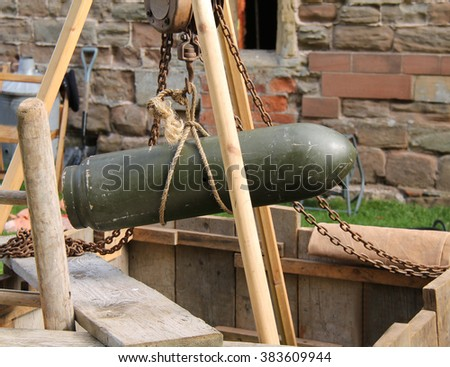 A Mock Up of Lifting an Unexploded Wartime Bomb. - stock photo