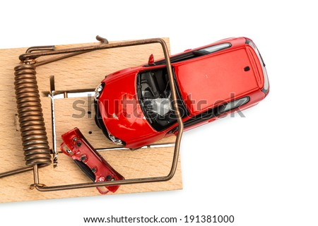 a model car in a mousetrap, symbolic photo for car expenses and liabilities - stock photo