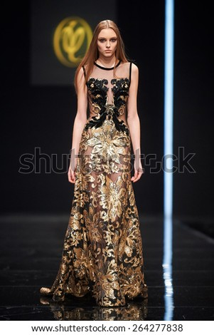 A model walks on the VALENTIN YUDASHKIN catwalk. Fall 2015. FASHION WEEK in MOSCOW. 25 March 2015, Moscow, Russia. - stock photo