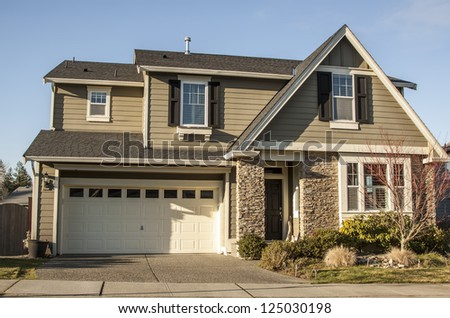 A modern American house front entrance with green grass - stock photo