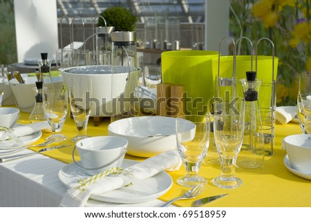 A modern and beautiful decorated dining table setting. - stock photo