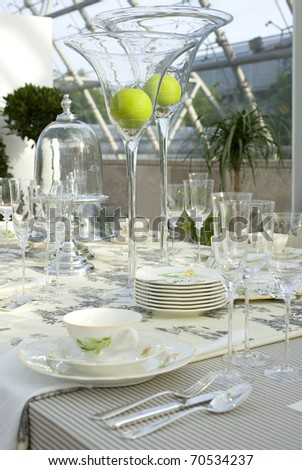 A modern and festive decorated wedding table. - stock photo