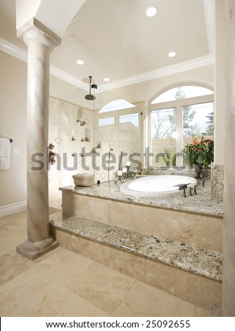 A modern bathroom with two sinks and dark wood walls - stock photo