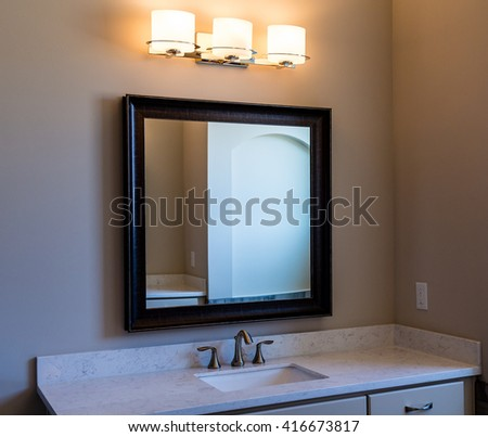 A Modern Bathroom with Vanity Mirror and Lights
