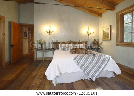 A modern bed room with dark wood walls - stock photo