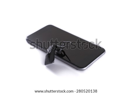 A modern bluetooth wireless headset - headphone with a smartphone - isolated on white - stock photo