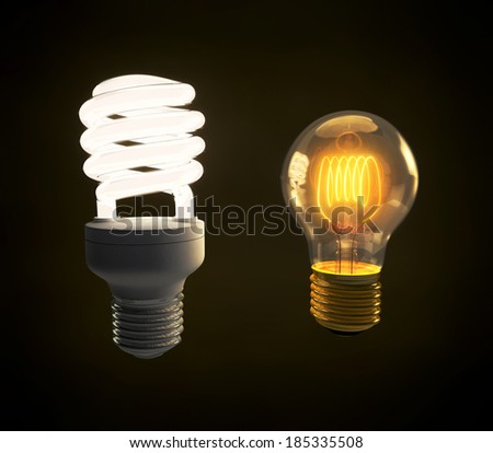 A modern green energy fluorescent and a vintage incandescent light bulb side by side - stock photo
