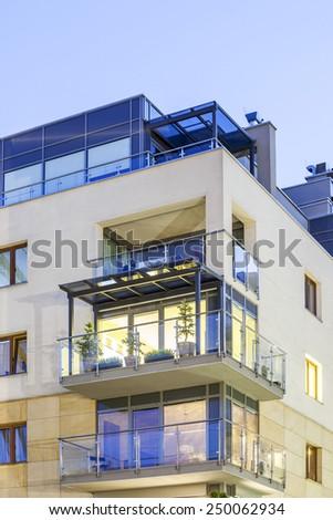 A modern illuminated nice apartment with balcony. - stock photo