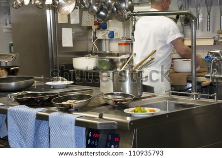 A modern kitchen in a hotel or restaurant with chef