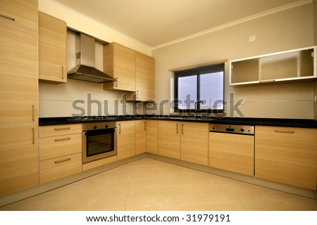 A modern kitchen interior photo