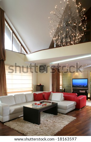 A modern living room interior with fireplace and leather couch - stock photo