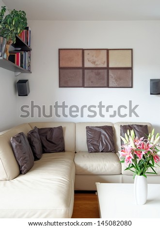 A modern living room with a  table and leather sofa - stock photo