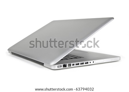 A modern metallic laptop that is half way open displayed from the side view on a white background