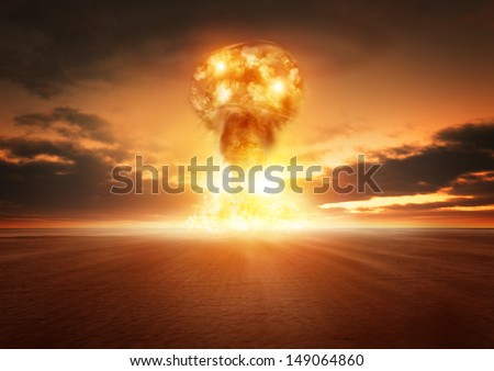 A modern nuclear bomb explosion in the desert. - stock photo