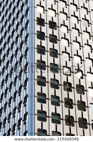 A modern offices building  illuminated by the sun - stock photo