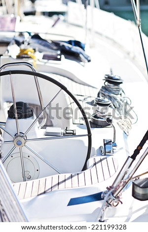a modern sailing yacht steering wheels - stock photo