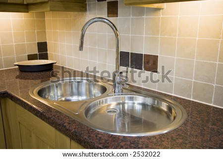 A modern stainless sink double sink - stock photo