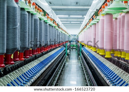a modern textile factory, auto coner in textile spinning unit, - stock photo