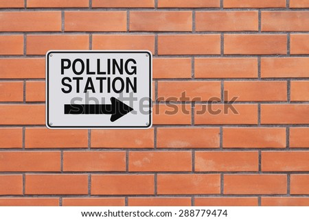 A modified one way sign indicating Polling Station  - stock photo