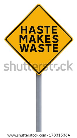 A modified road sign indicating Haste Makes Waste