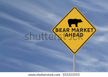 A modified road sign warning of a �bear market� ahead on a blue sky background with copy space
