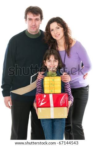 A mom and dad are hugging her daughter holding a pile of presents in boxes