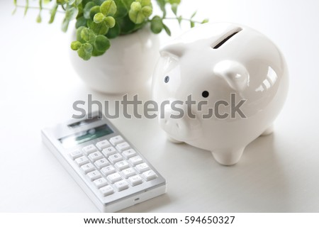 A money box and electronic calculator