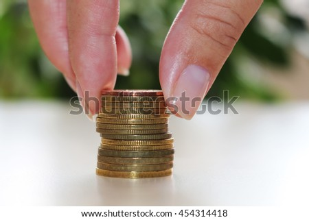 A money saving concept.Female hand stacking money coin , growing business. - stock photo