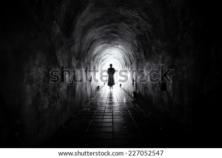 A Monk inside the Tunnel in Light of Shadows