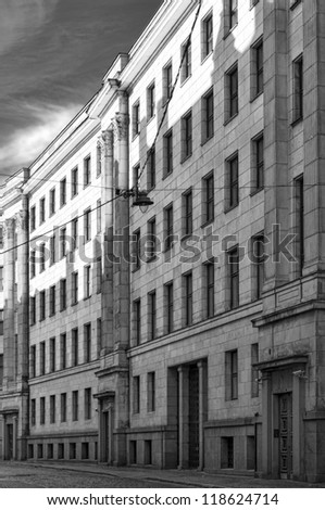 A monochromatic image of a street in the Latvian capital of Riga with typical soviet style architecture. - stock photo