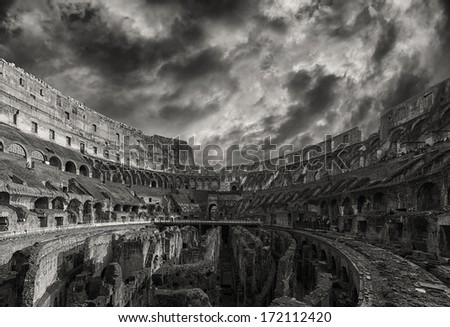 A monochromatic view of the impressive ancient roman colosseum situated in the Italian capital of Rome. - stock photo