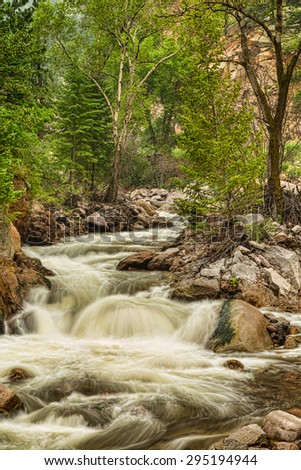 A monochrome nature landscape view up a cascading Colorado Rocky Mountain stream the south St Vrain Creek in the south St Vrain Canyon  and getting hypnotized by nature.    - stock photo