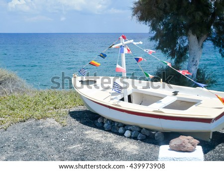 a monument to the fishermen on the island of Santorini - stock photo