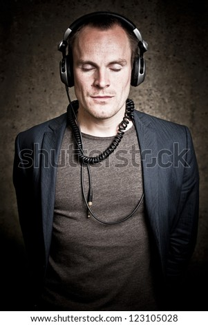 A moody image expressing the deep love for music, coming from tis young adult. - stock photo