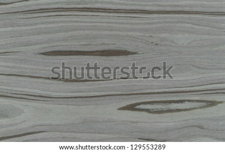 A more modern style of lighter colored wood grain texture that tiles seamlessly as a pattern