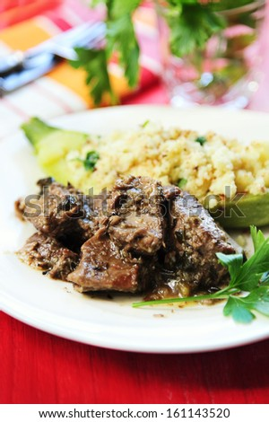 A Moroccan couscous with tender lamb - stock photo