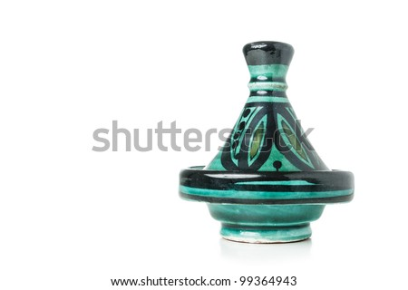 A moroccan handmade ceramic Tajine isolated on a white background