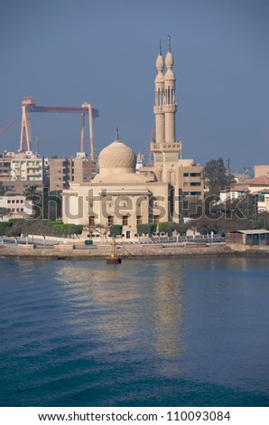 A mosque beside the Suez Canal in Port Suez. Port Suez is the southern transit point for the canal