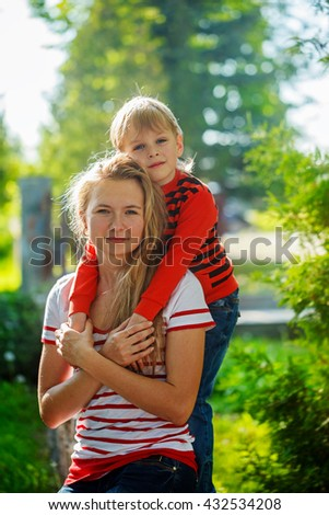 A mother and child at the her hands on nature. Childhood and happy family concept - stock photo