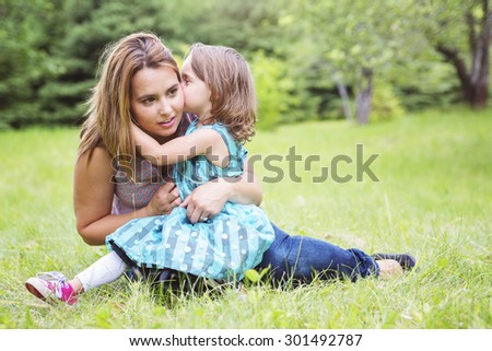 A Mother and daughter in forest having fun