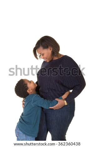 A mother and son embracing isolated on white