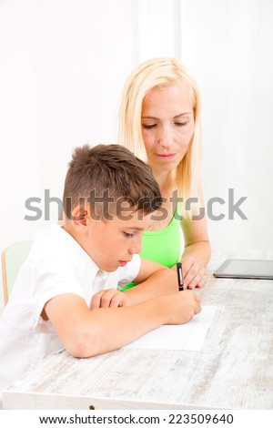 A mother helping his son with his homework.