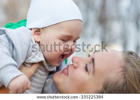 A mother hugging her cute little son. Shallow dof - stock photo