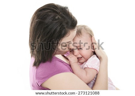 A Mother trying to calm her crying baby isolated on white background - stock photo