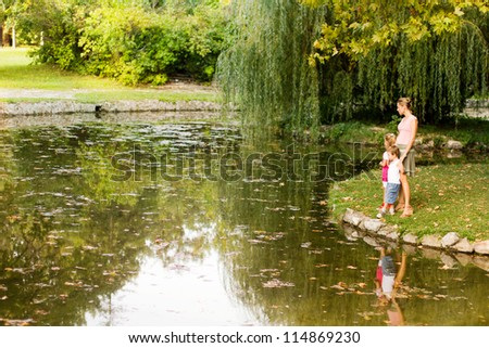 A mother with daughter and son at park - stock photo