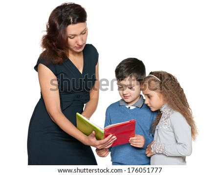 A mother with her children are reading a book