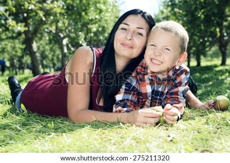 A mother with is son on apple background